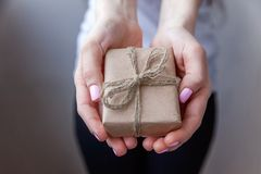 Female hands holding small gift box royalty free stock images