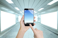 Female hands holding smart phone finger touching screen Stock Photography