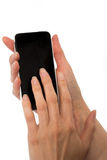Female hands holding smart phone Stock Images