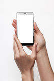 Female hands holding smartphone with blank screen Stock Photo