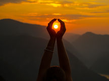 Female hands holding sun Royalty Free Stock Photo