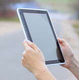 Female hands holding a tablet Stock Photos