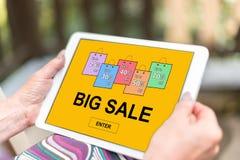 Big sale concept on a tablet. Female hands holding a tablet with big sale concept Stock Photos