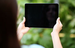 Female hands holding tablet computer Stock Image