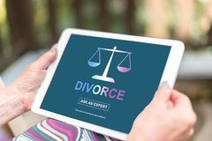 Divorce advice concept on a tablet. Female hands holding a tablet with divorce advice concept Stock Photo