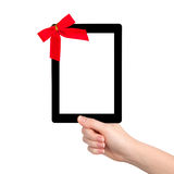 Female hands holding a tablet with isolated screen and a red gif Stock Photos