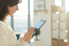 Female hands holding tablet pc, typing, using touchscreen and wi-fi internet Royalty Free Stock Photography