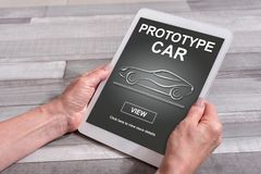 Prototype car concept on a tablet. Female hands holding a tablet with prototype car concept Royalty Free Stock Photography