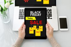 Female hands holding tablet with sale black friday screen Stock Images