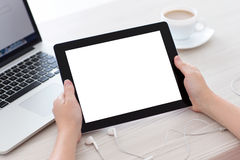 Female hands holding a tablet with  screen against the b Stock Image