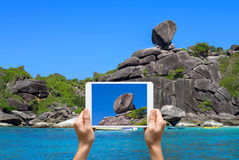 Female hands holding tablet taking pictures Similan islands, Bea Stock Photography