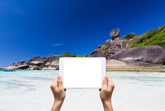 Female hands holding tablet taking pictures Similan islands, Bea Royalty Free Stock Photography
