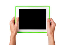 Female hands holding a tablet Stock Photography