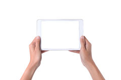 Female hands holding a tablet touch computer gadget Royalty Free Stock Photos