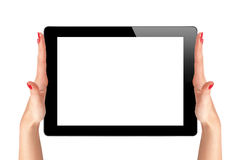 Female hands holding a tablet touch computer Royalty Free Stock Images
