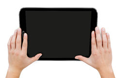 Female hands holding a tablet touch computer gadget Royalty Free Stock Photography