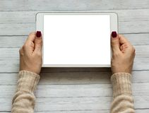 Female hands holding a tablet touch computer gadget with screen royalty free stock images