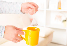 Female hands holding tea bag Royalty Free Stock Images