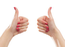 Female hands holding thumbs up on white Royalty Free Stock Photography