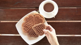 Female hands holding waffle dish Royalty Free Stock Images
