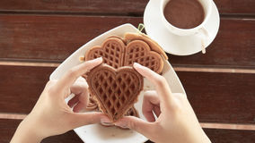 Female hands holding waffle dish Royalty Free Stock Photography