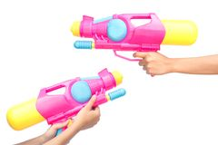 Female hands holding water gun on a white background royalty free stock photo