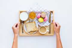 Free Female Hands Holding Wooden Tray With Macaroons Stock Image - 142282071