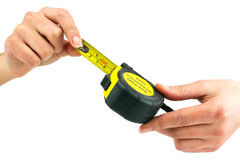 Female hands holds measuring tape Royalty Free Stock Photography