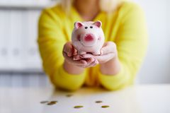 Female hands holds piggy bank. Close up Stock Photo