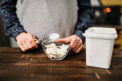 Female hands holds spoon with margarine over bowl Stock Images