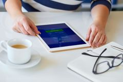 Woman with digital tablet, view close up. Female hands holds a tablet with online shop on screen royalty free stock photography