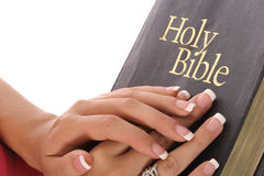 Female hands on holy bible Royalty Free Stock Photography