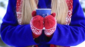 Female hands with hot drink outdoors on winter day stock video
