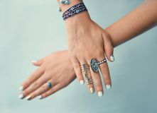 Female hands with jewelry. On color background Royalty Free Stock Images