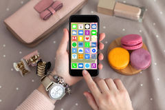 Female hands jewelry holding phone with home screen icons apps Royalty Free Stock Images