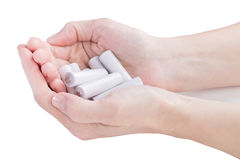 Female hands are kept in an armful batteries Stock Photo