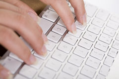 Female hands on keyboard Stock Photo