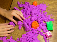 The female hands with kinetic sand Stock Image