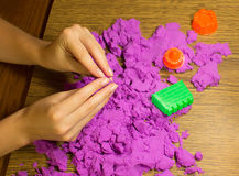 The female hands with kinetic sand Royalty Free Stock Images