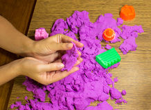 The female hands with kinetic sand Stock Photos