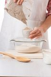 Female hands knead the dough Stock Photos