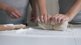 Female hands knead pasta dough.  stock footage