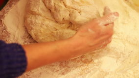 Female hands kneading dough in flour on table stock video footage