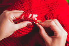 Female hands knits sweater Royalty Free Stock Photos