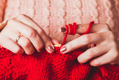 Female hands knits sweater Royalty Free Stock Photography