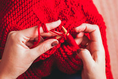 Female hands knits sweater Royalty Free Stock Images