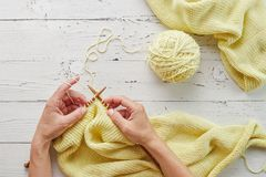 Woman hands knitting with needles and yarn Stock Photo