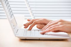 Female hands on laptop Royalty Free Stock Image