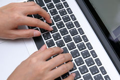 Female hands on laptop Stock Photo