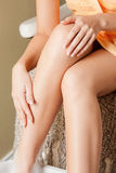 Female hands and legs in spa salon Royalty Free Stock Image